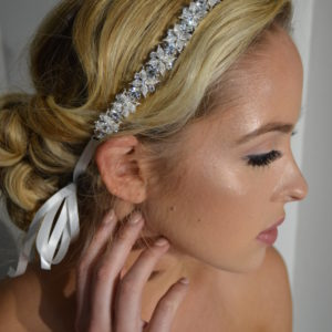 Crystal & rhinestone flower headband with ribbon ties.