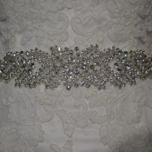 Rhinestone embellished belt with organza ties.