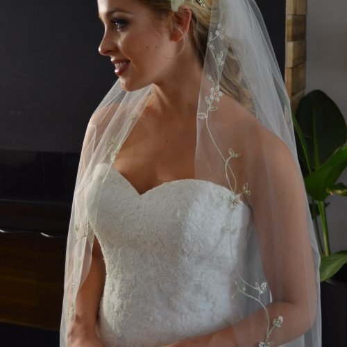 E1210 One tier veil with embroidered floral vines along the edge embellished with beaded floral accents.