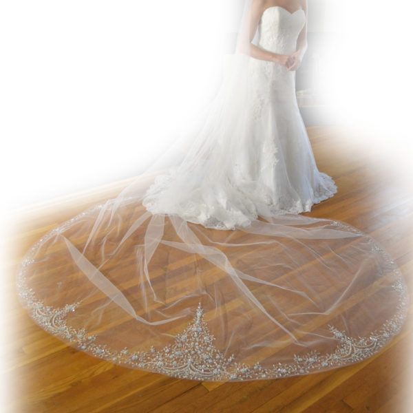 E1211 Cathedral length veil with heavily embellished edge with silver embroidery, silver beading, & rhinestones.
