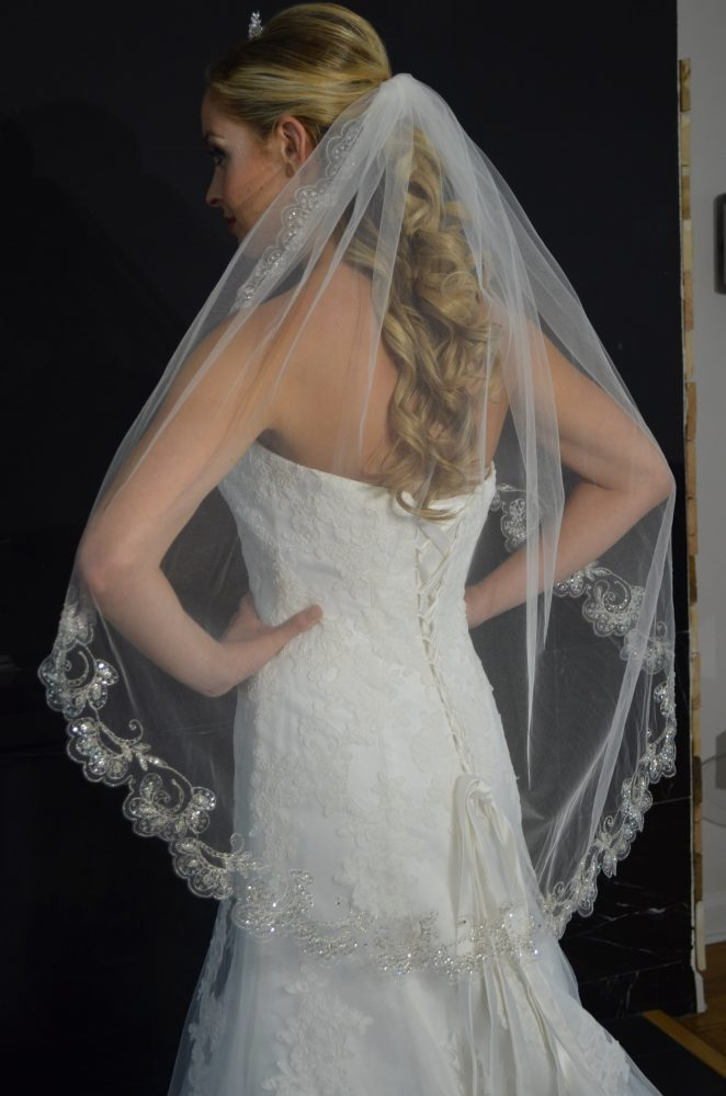 E1213 One tier fingertip veil with silver embroidered scallop edge with beading & sequins.