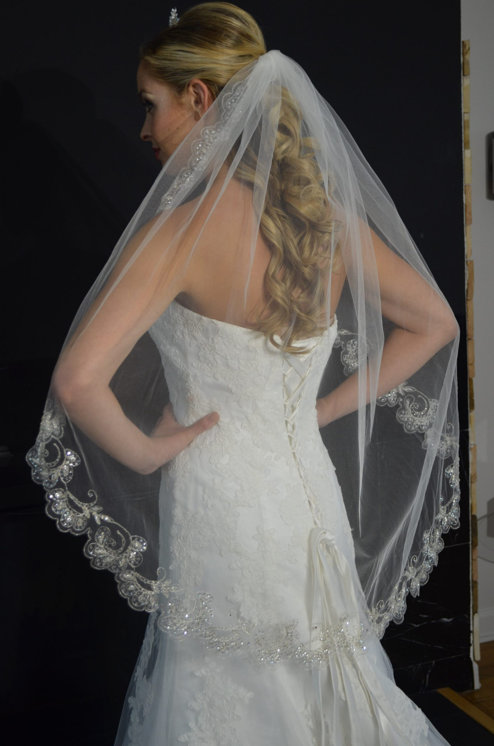 Elena E1213 One tier fingertip veil with silver embroidered scallop edge with beading & sequins.