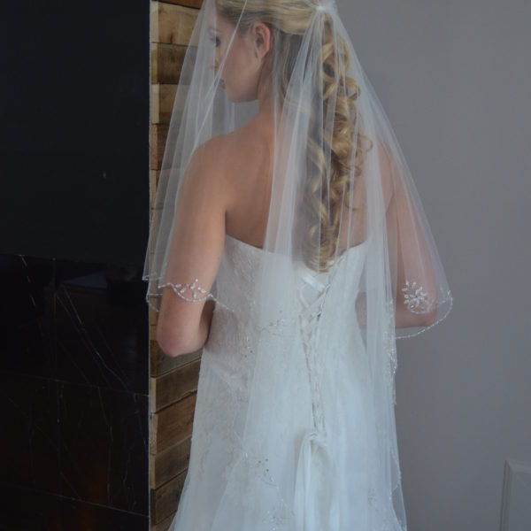 E1215 Two tier fingertip length veil with beaded scallop edge & rhinestone accents.