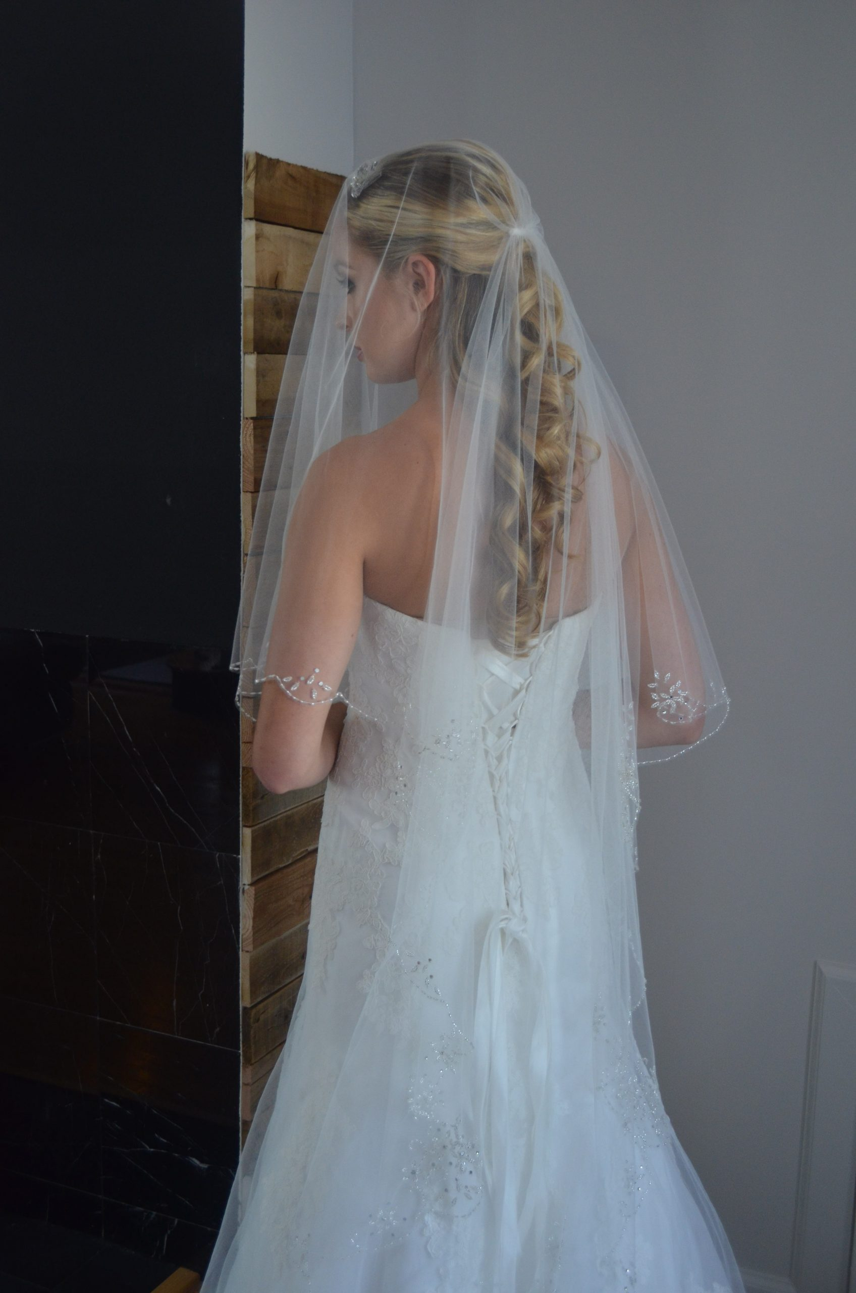 Elena E1215  Two tier fingertip length veil with beaded scallop edge & rhinestone accents.