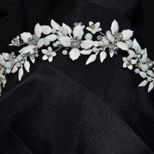 Painted white leaved floral headband with rhinestones and milk crystals.
