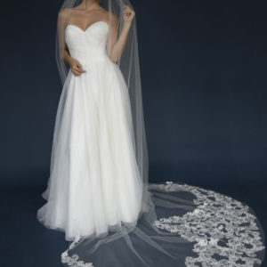 Cathedral veil with lace appliques encrusted in rhinestones & beaded with crystals.